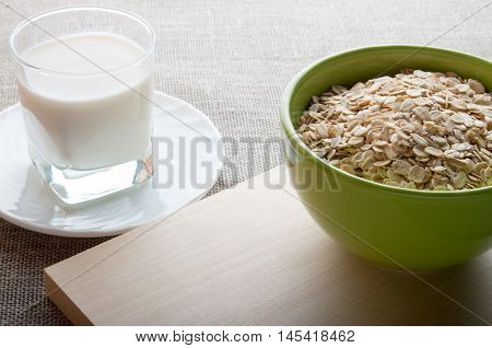 Green Bowl Of Dry Cereal On A Wooden Board