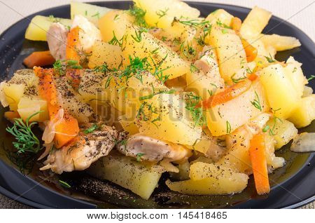 Homemade Dish Of Slices Of Stewed Potatoes, Chicken, Carrot And Onion