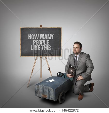 How many people like this text on blackboard with businessman and toy car