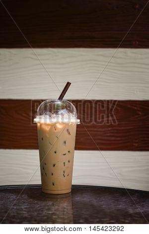 Iced Coffee In Takeaway Cup On Marble Table With Blurred Two Tone Wooden In Background,selective Foc