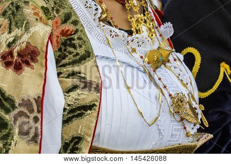 SELARGIUS, ITALY - September 13, 2015: Former marriage Selargino - Sardinia - detail of traditional Sardinian costumes of the folk group