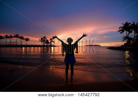 Girl With Arms Wide Open At Beach Sunset
