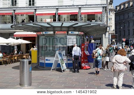 LUCERNE SWITZERLAND - MAY 06 2016: Unrecognized passers do some shopping at a kiosk offering a variety of tickets. Tickets sales in heavily used areas is very helpful for residents and tourists