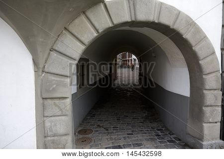 Lucerne Switzerland - May 02 2016: The narrow passage between the two streets of the old town shows the tourist attractiveness of the city for walkers. There is one man who can be seen in a far distance.