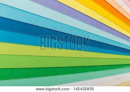 Sheets of colored paper, iridescent palette of colored paper, rainbow colors