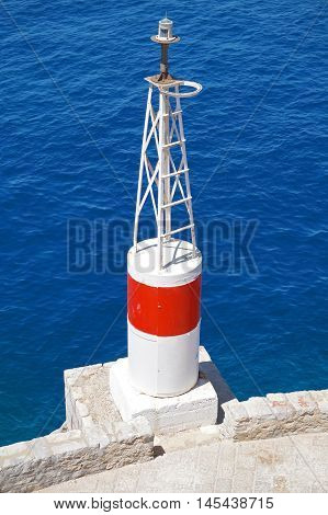 Sea Navigation Beacon Tower on a Deep Blue Background