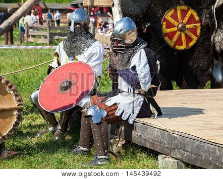 SAMARA RUSSIA - JUNE 18 2016: Two unidentified knights in armor after fighting. Historical restoration of knightly fights on free festival of medieval culture