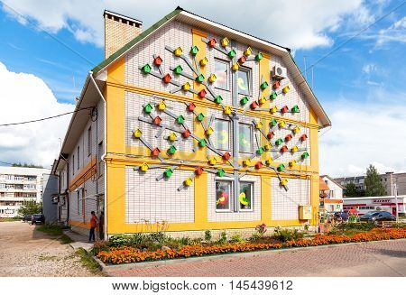 BOROVICHI RUSSIA - AUGUST 3 2016: Colorful wooden birdhouses mounted on the facade of the building