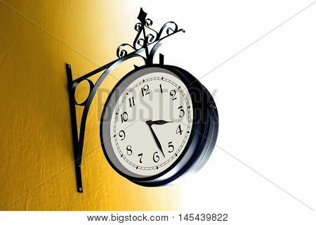 Vintage Clock on a Yellow Wall / Daylight Saving Time Concept