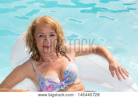 Summer Vacations Image With Adult Midlife Woman Relaxing In Pool