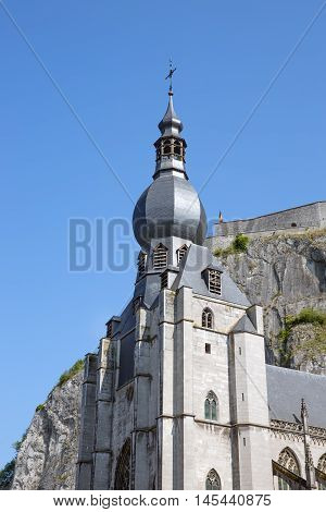 Looking up to the Church and citadel of Dinant Belgium