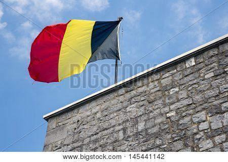 Belgian flag in top of citadel Dinant in Belgium