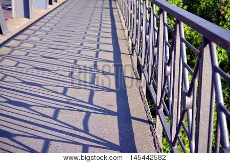 handrail city bridge with shadow of the structure
