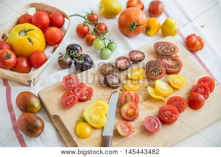Fresh heirloom tomatoes background, organic produce at a Farmer's market