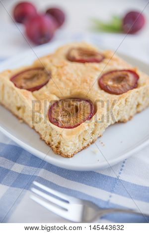 home made vanilla plum cake on a plate