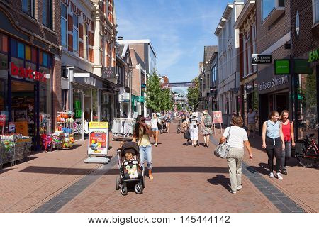 Apeldoorn, The Netherlands - August 23, 2016: People at Apeldoorn's Markstraat main street, known as a popular shopping street for locals and tourists.