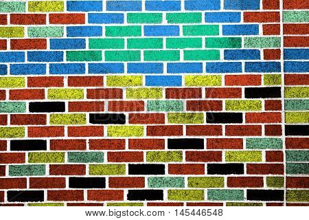 A brick wall background that is multicoloured.