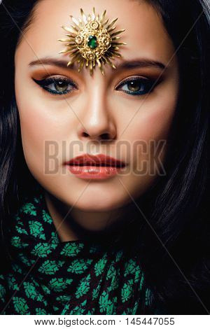 beauty eastern real muslim woman with jewelry close up, bride with star creative makeup, modern art concept