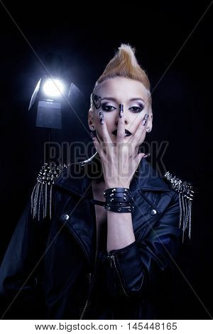Fashion Rocker Style Model Girl Portrait. Hairstyle. Punk Woman Makeup, Hairdo and black Nails. Smoky Eyes hairstyle. music star