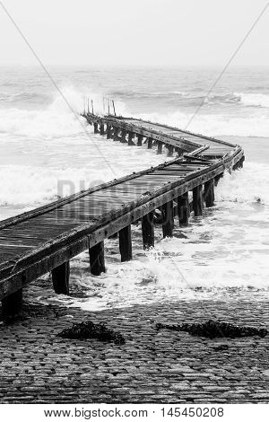 little bridge in Normandy with rough sea