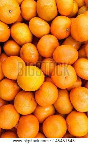 Ripe tangerines as background. background fresh fruit