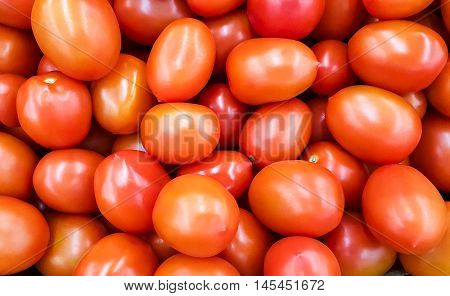 Background of red tomatoes. Background of fresh vegetables
