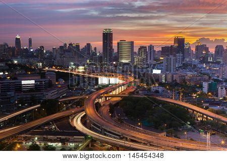 Cityscape downtown with highway interchanged and sunset sky background