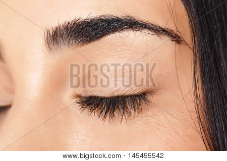 Closed eye of young beautiful woman with daily make up.