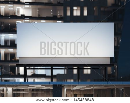 White billboard standing on a modern office building at night. 3d rendering