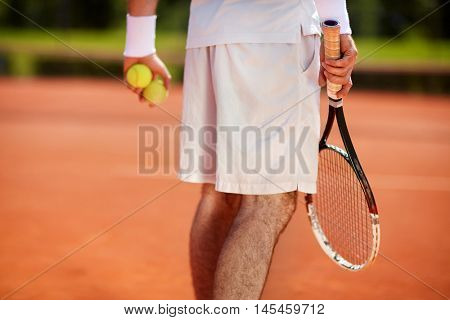 Close up of body part of sportsman on tennis court