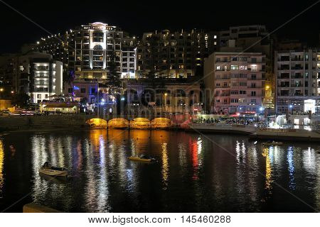 Saint Julian's, Malta - August 04 2016: Nightlife view of Saint Julian's bay. Saint Julian is the patron saint of the maltese town.