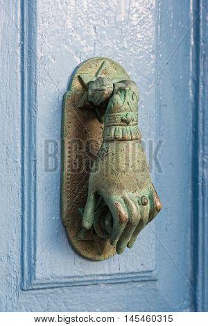 Knocker on old wooden door in Nisyros island, Greece