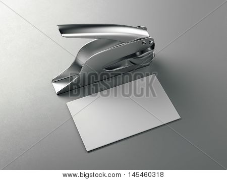 Metal embosser with white business card on gray floor. 3d rendering