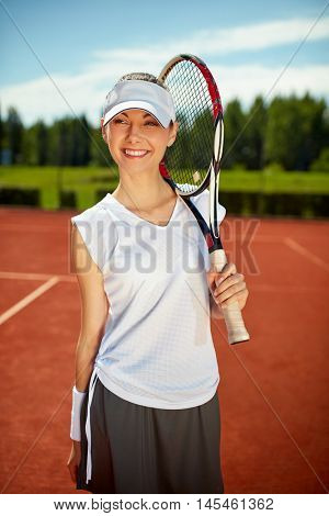 Girl with tennis racket picked up on tennis court