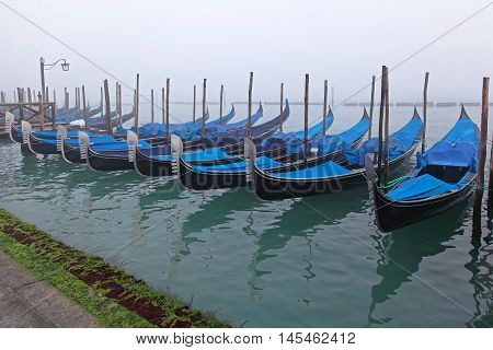 Venice Gondolas at Their Moorings in Fog