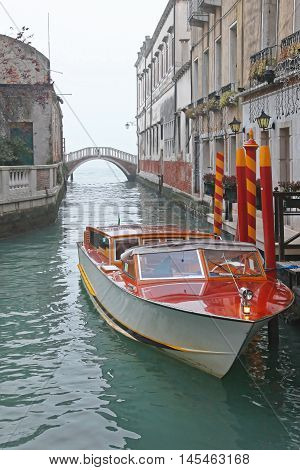 Water Taxi Boat Moored at Canal in Venice