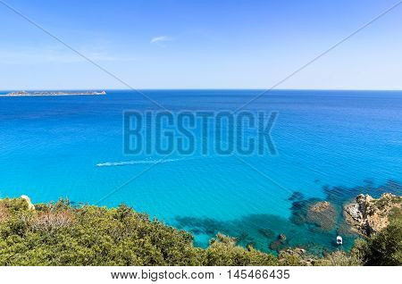 Mediterranean Turquoise Sea With Snorkeling Boat Under The Clear Blue Sky