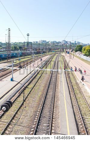 BELGOROD RUSSIA - August 30.2016: Railway platform of municipal train station. Passengers go to landing in a train