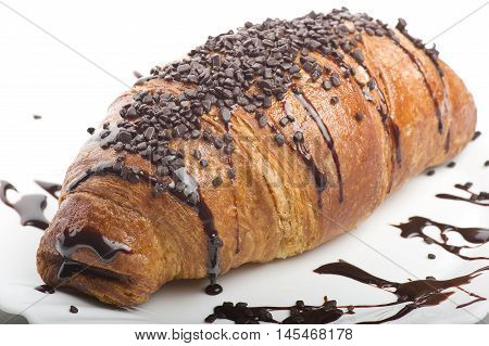 croissants with chocolate on a white plate