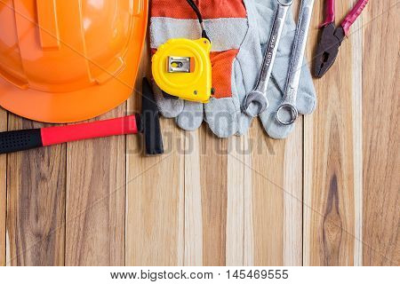 Safety equipmenttool kit for construction on wooden table background with copy space