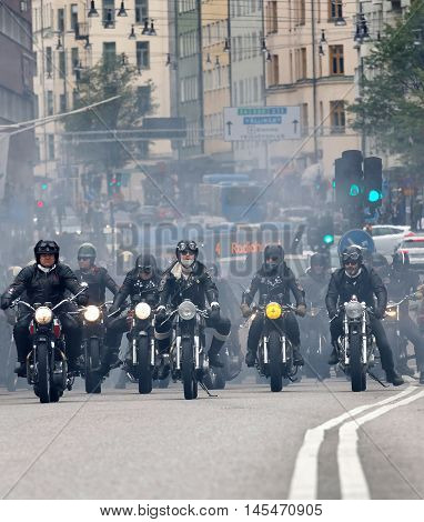 STOCKHOLM SWEDEN - SEPT 03 2016: Group of bikers on old fashioned motorcycles at the Mods vs Rockers event at the Saint Eriks bridge Stockholm Sweden September 02 2016