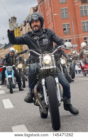 STOCKHOLM SWEDEN - SEPT 03 2016: Closeup of old fashioned motorcycles and bikers at the Mods vs Rockers event at the St:Eriks bridge Stockholm Sweden September 03 2016