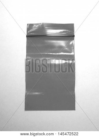 Plastic bag with zipper closeup photo in black and white