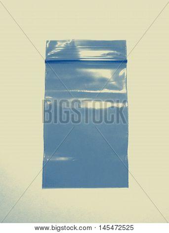 Plastic bag with zipper closeup photo in retro style