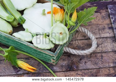 Full Wooden Tray Of Courgettes And Squashes