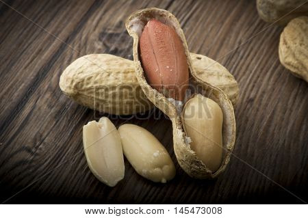 Peanuts in shells close up on the wood table