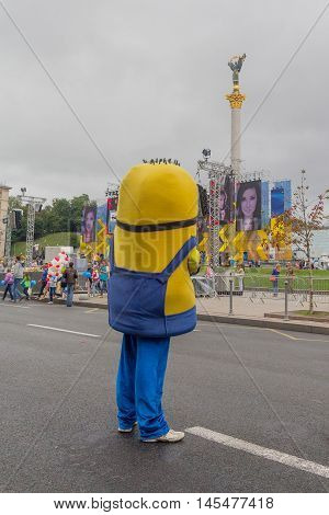 Kiev Ukraine - August 24 2016: Man in a suit looking at the Monument Independence during the celebration of the anniversary of Independence of Ukraine