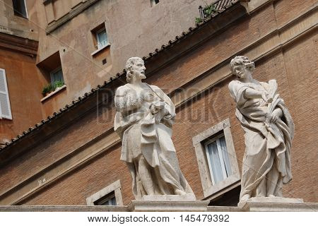 Building and statues near the Papal Basilica of Saint Peter in the Vatican