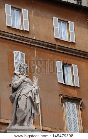 Building and statue near the Papal Basilica of Saint Peter in the Vatican