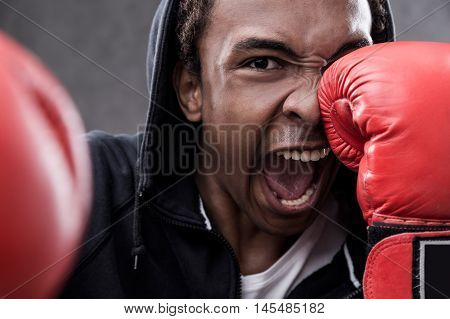 African American Man Hitting With Boxing Gloves